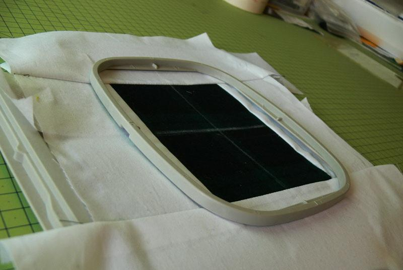 Horizontal and vertical axes on green fabric in the hoop