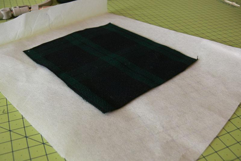 Piece of green checkered fabric on adhesive stabilizer