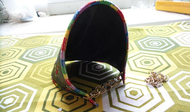 Black leather bracet with embroidery and chain