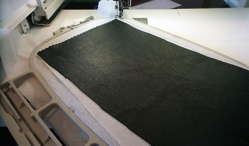 Piece of reinforced black leather