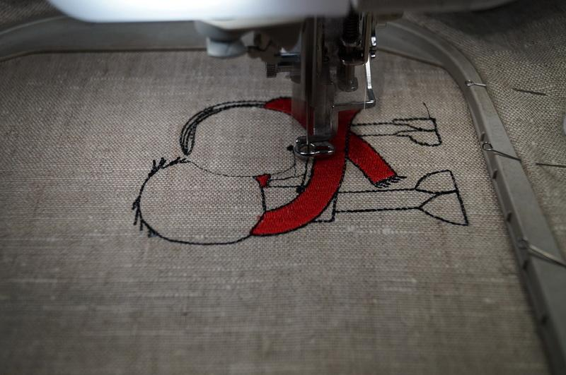 Red and black design embroidered on linen