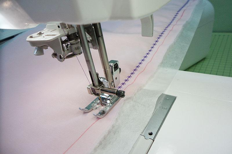 Decorative stitch on pink fabric