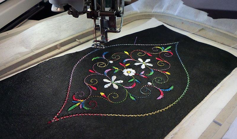 Machine embroidered design on black leather