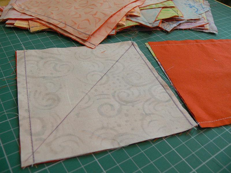 Square pieces of fabric with diagonal lines on them