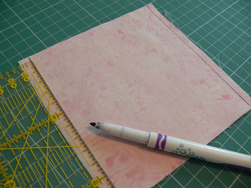 Pink fabric, sewing ruler and embroidery pen
