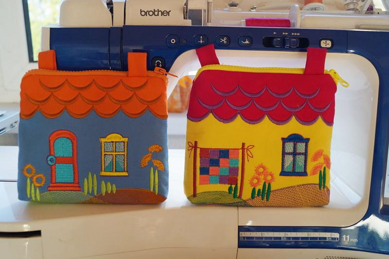 Two little girl's bags in the shape of houses