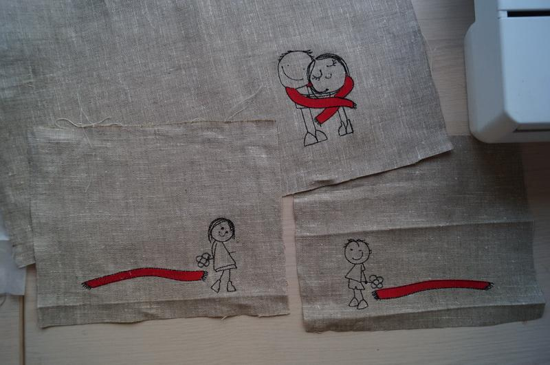Red and black boy and girl designs embroidered on linen