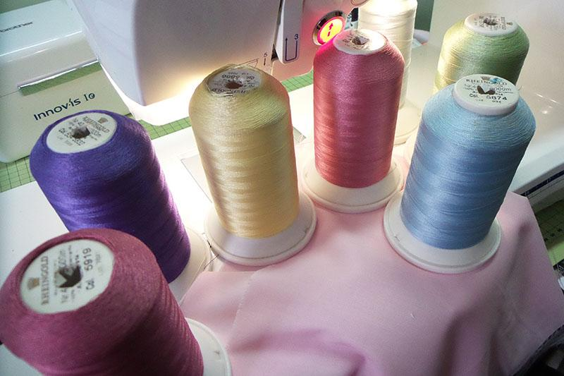 Spools of embroidery threads of various colors