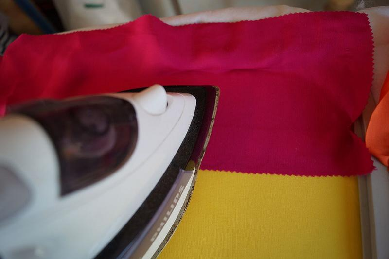 Fusing red and yellow fabric to stabilizer