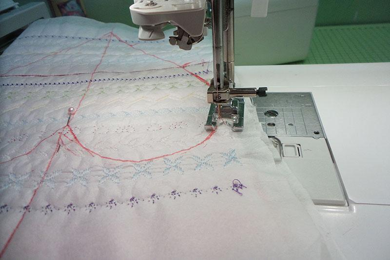Red heart-shaped outline on embroidered fabric