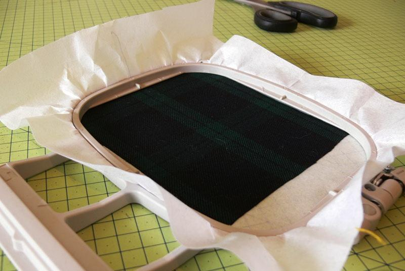 Piece of green checkered fabric in the hoop