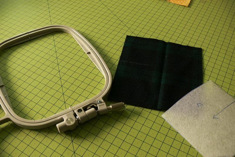 Hoop, green fabric and stabilizer