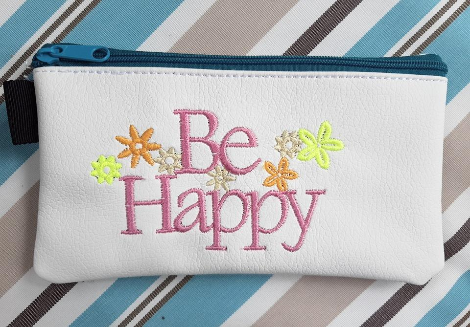 Embroidered handbag with Be happy free design