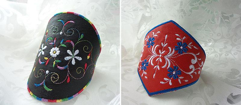 Bralck and red embroidered leather bracelts