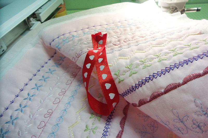 A red hanger with hearts