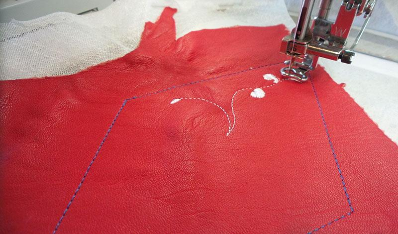 Piece of red leather with outline