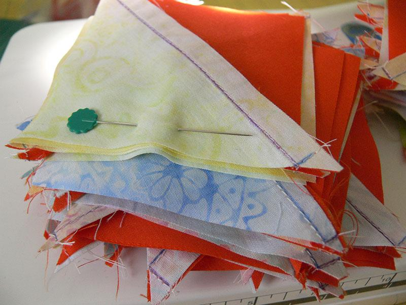 Multi-colored triangular pieces for patchwork quilt