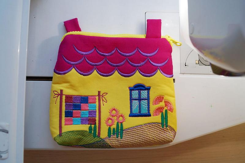 Red and yellow kids bag in the shape of a house