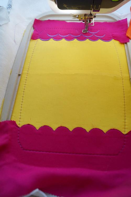 Yellow and red fabric stitched together