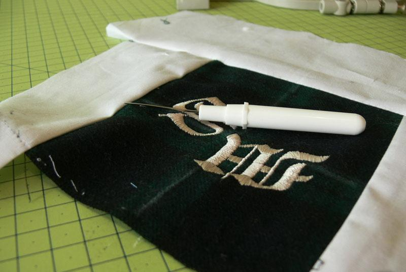Embroidered fabric and ripper