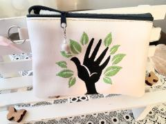 Embroidered cosmetics bag with Hand and leaves design
