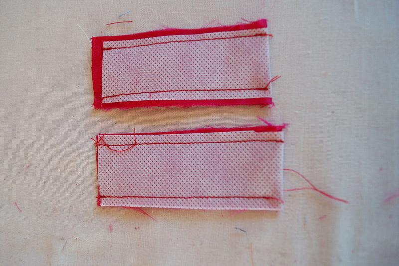Two strips of fabric for making eyelets