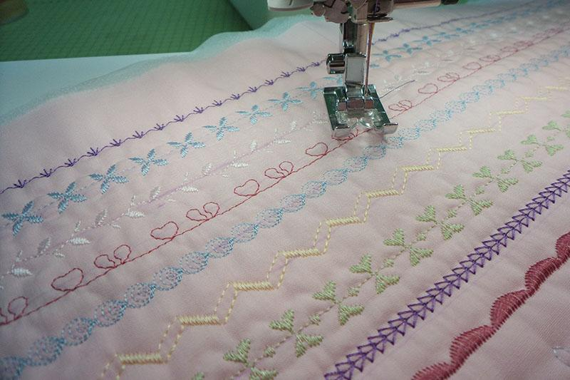 Pink fabric with rows of decorative stitches