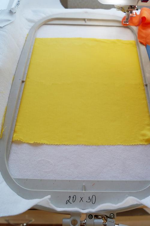 Yellow fabric with stabilizer in the hoop