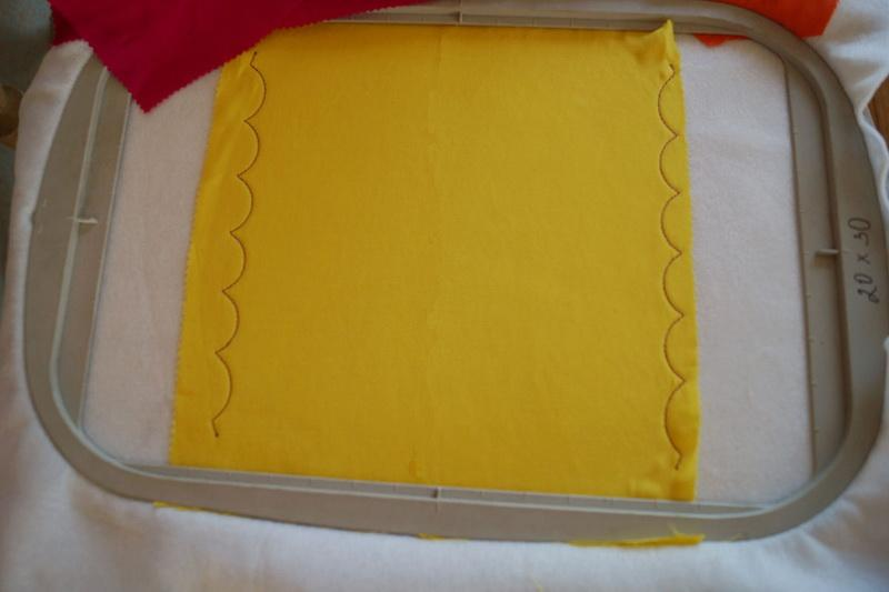 The outline of the future design on yellow fabric