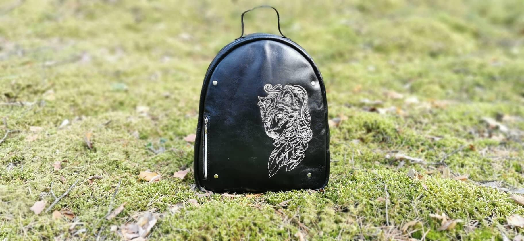Embroidered backpack with Wolf design