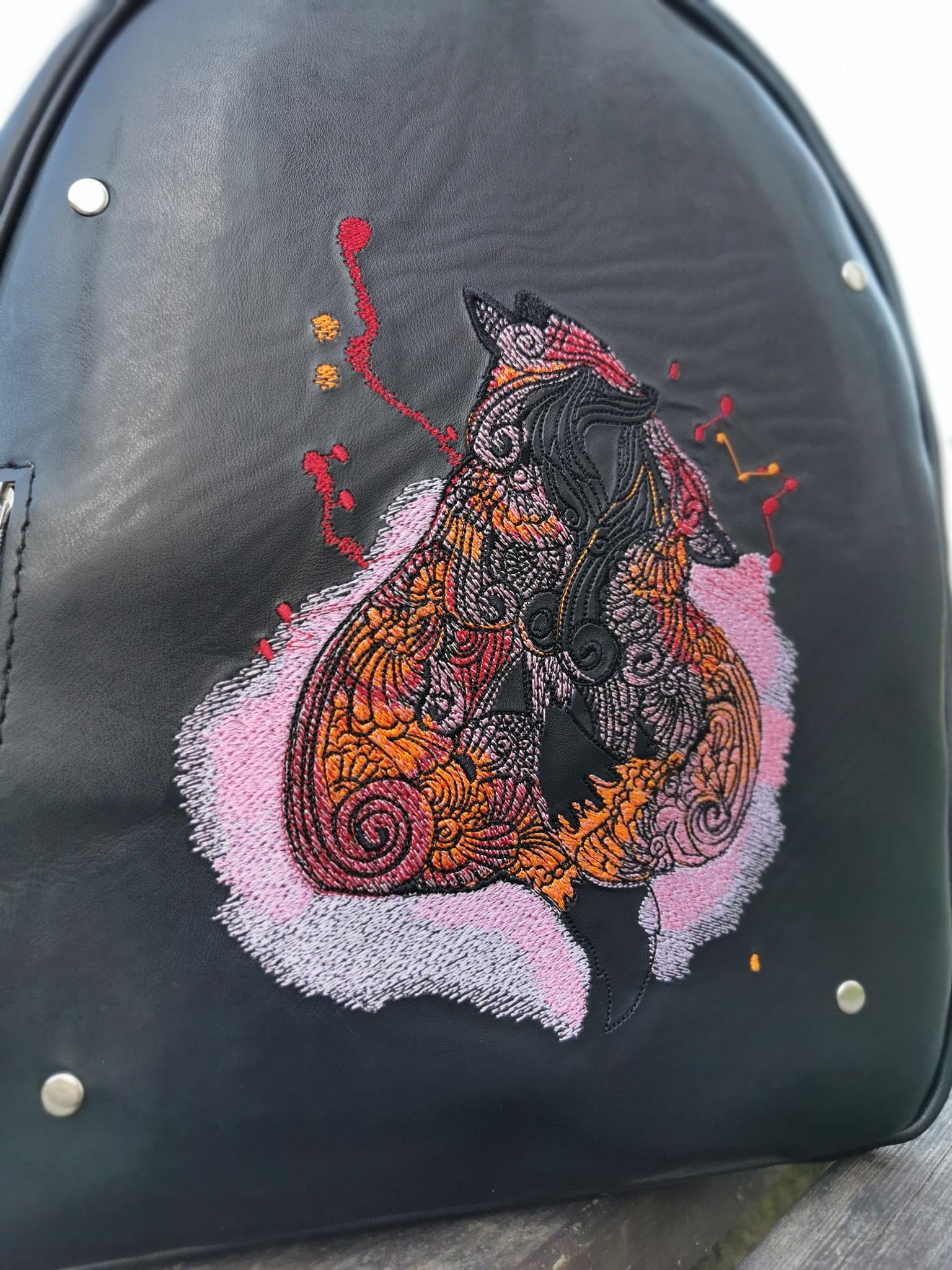 Embroidered backpack with Fox couple design