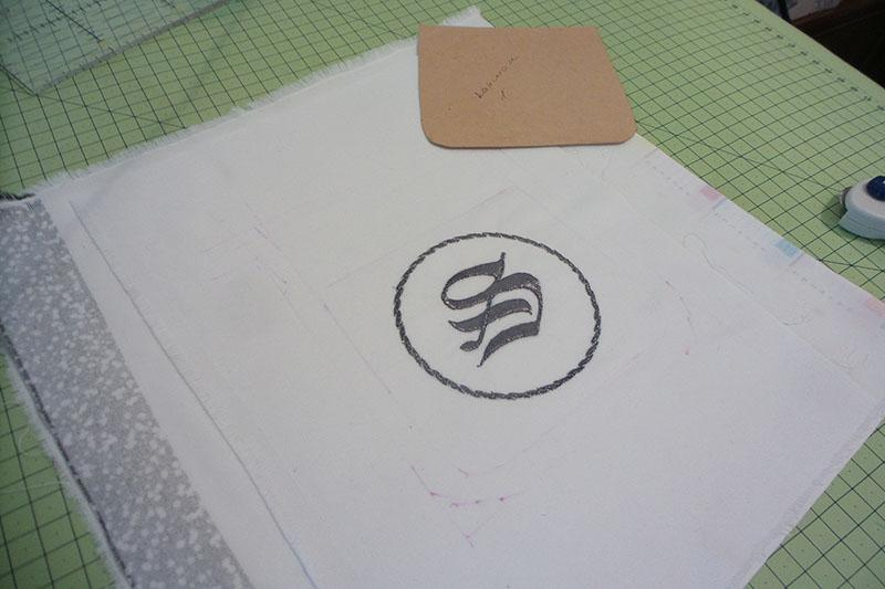 Silver letter embroidery