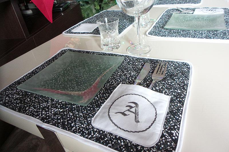 Black placemat with embroidered pocket on table