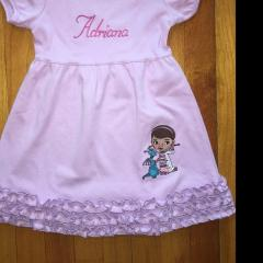 Embroidered dress with Doc McStuffins design