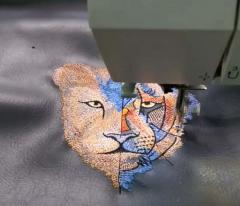 Embroidering artistic lion design