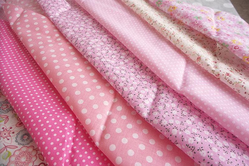 Stack of pink girly fabrics