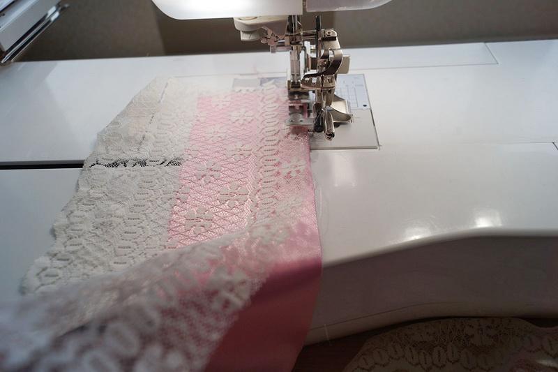Stitching white lace to pink fabric