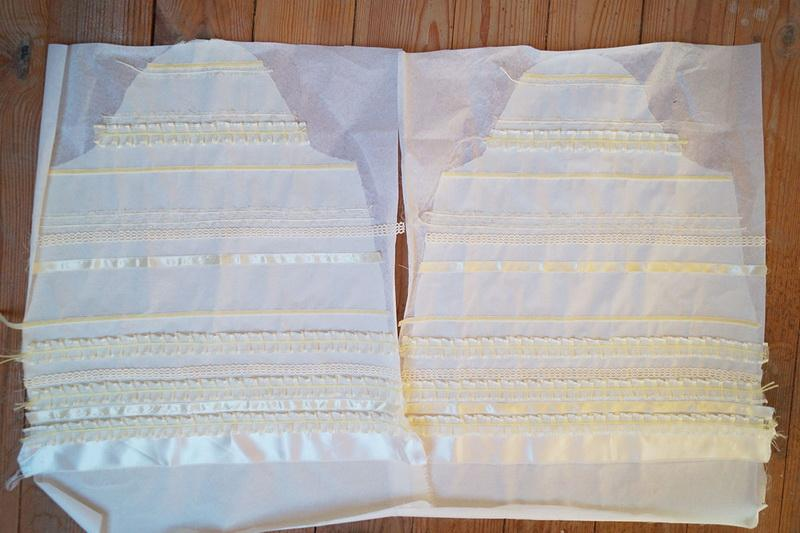 White ruffles on white unstitched sleeves