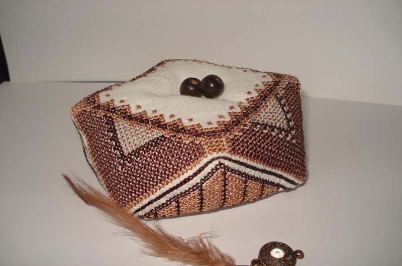 Biscornu decorated with beads