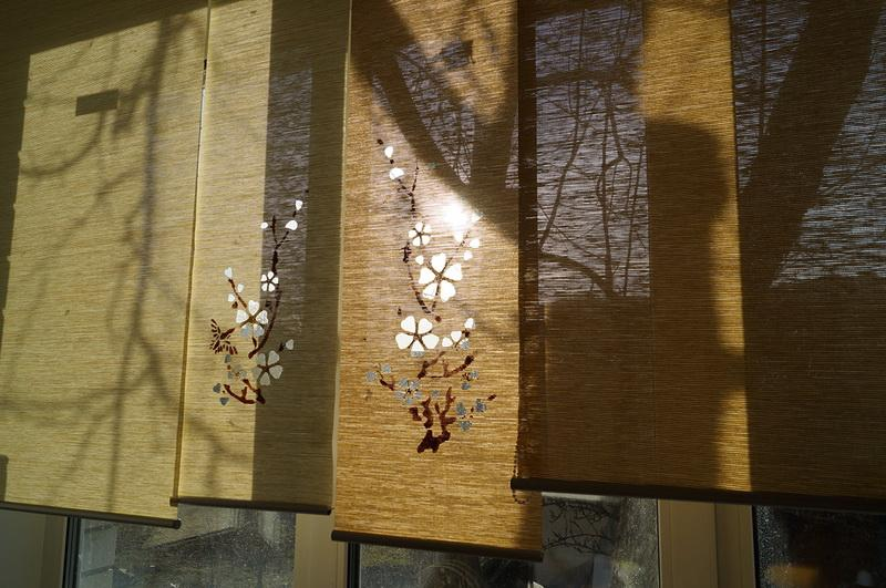 Roller shades with cherry tree branches