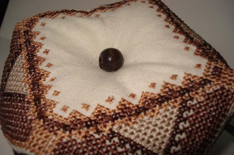 Biscornu with a bead