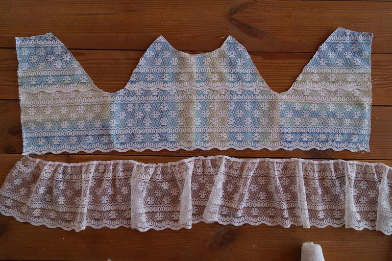 Part of the girl's dress with lace