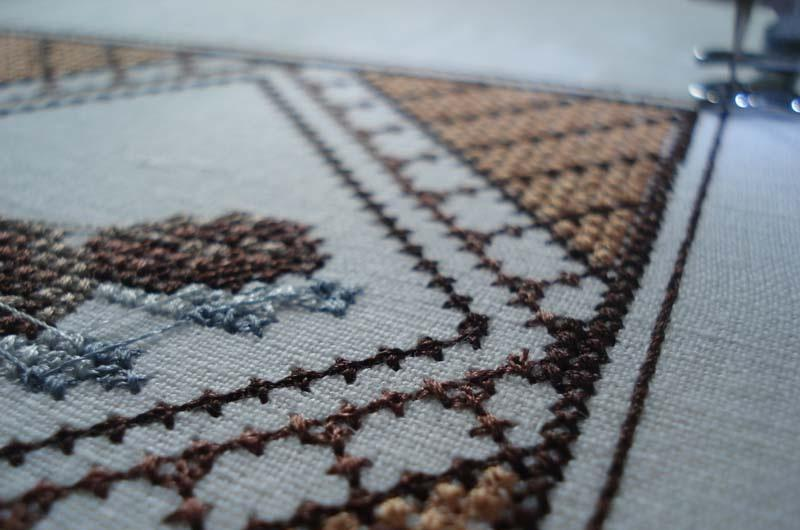 Backstitch at the edge of the square