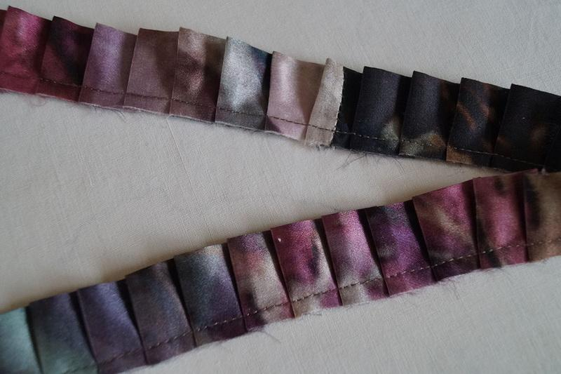 Flattened pleated colored ribbon