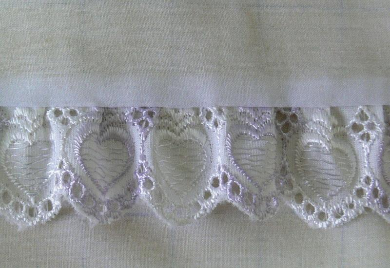 Lacy frills on white fabric