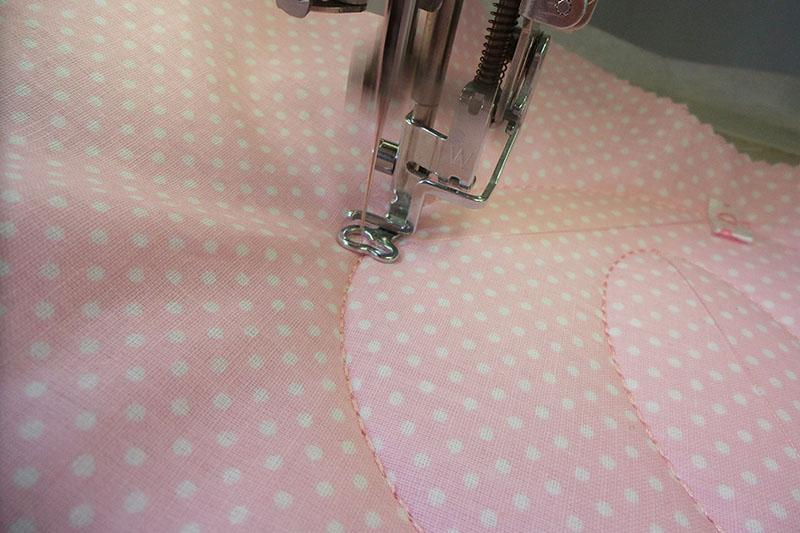 """Part of the letter """"oh"""" on pink fabric with dots"""