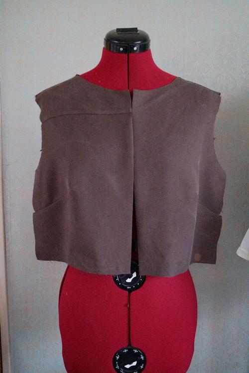 Half-finished jacket on mannequin