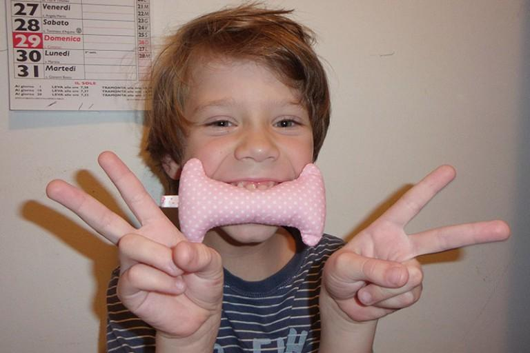 A kid with a soft three-dimensional letter