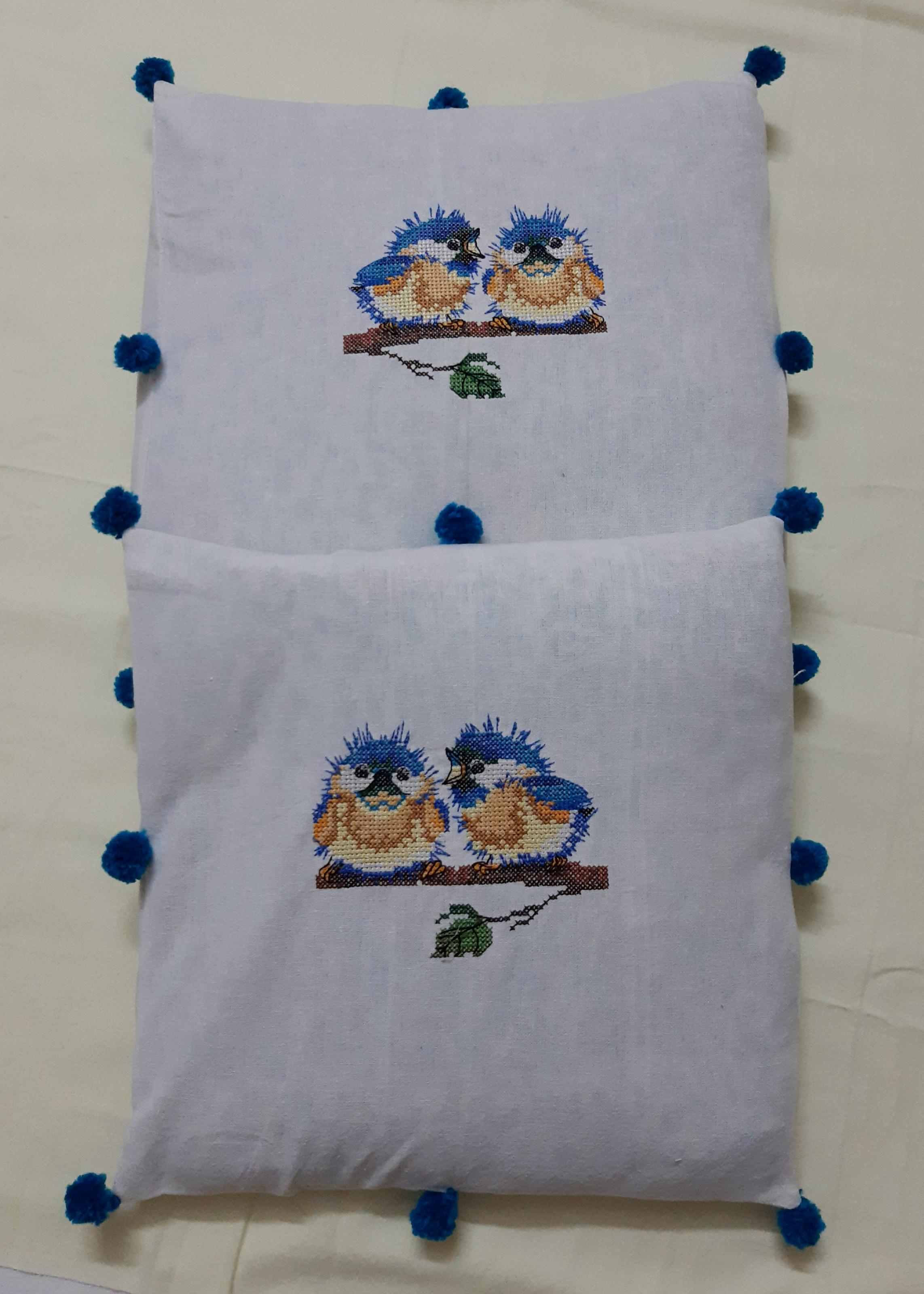 Cushion cover with embroidered birds