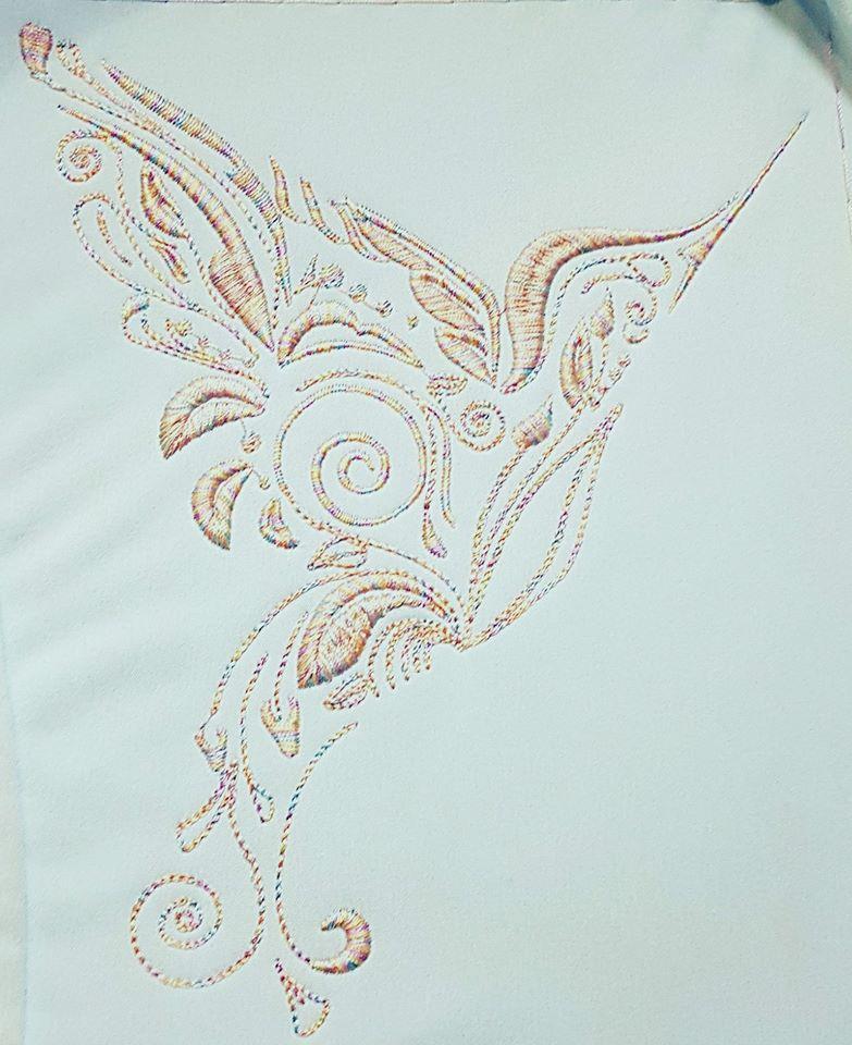 Embroidered colibri design